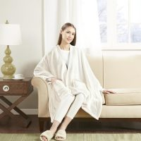 "50""x60"" Angel Wrap Plush Throw Blanket w/ Pockets (Cream)"